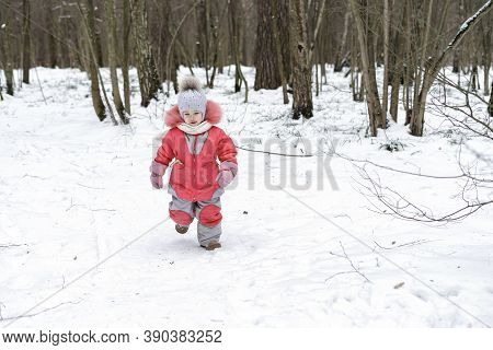 Little Girl Having Fun On Winter Day. Fun In The Fresh Air For A Christmas Mood