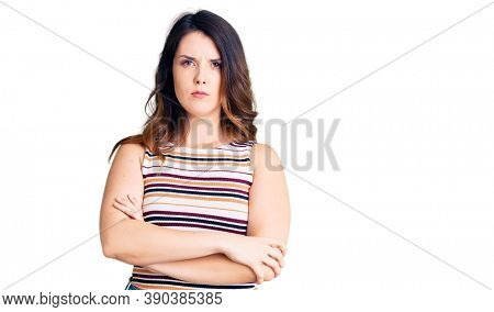 Beautiful young brunette woman wearing casual clothes skeptic and nervous, disapproving expression on face with crossed arms. negative person.