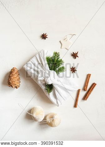 Flat Lay Fabric Wrapped Gift With Fir Tree Branch. Christmas Reusable Sustainable Gift Wrapping Alte