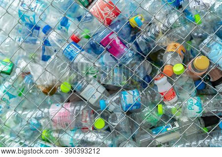 Chonburi, Thailand-october 11, 2020 : Pile Of Empty Water Plastic Bottle In Mesh Fence Recycle Bin.