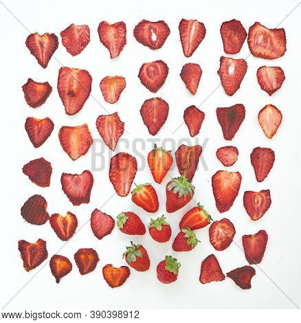 Fresh Strawberries And Dried Strawberries Slices On White Background.