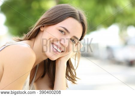 Happy Woman With Perfect Smile Looks At Camera In The Street