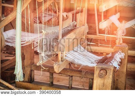 Retro Loom For Fabric Making. Traditional Vintage Weaving Machine For Creating Textiles., Textured