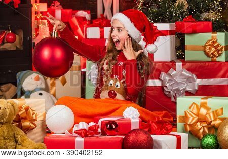 Happiness And Joy. Child Happy Girl Find Gifts Near Christmas Tree. Merry Christmas. Happy Childhood