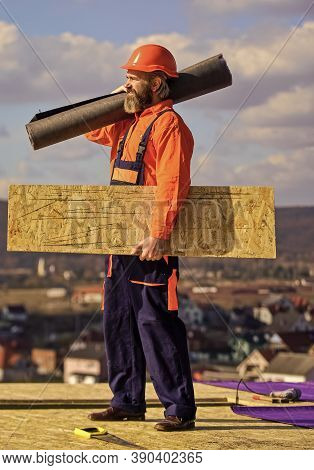 Provide Safe Access To Roof. Roofer Repair Roof. Roof Installation. Man Hard Hat Work Outdoor. Build
