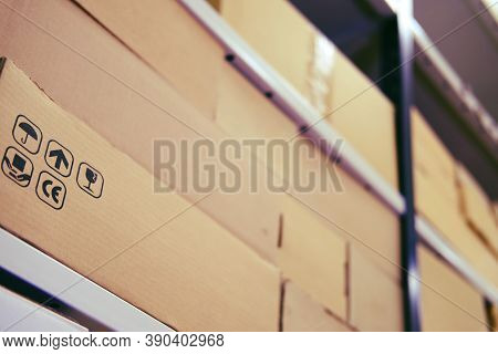 Warehouse Filled With Boxes Of Goods Quarantined Due To Coronavirus. Furniture Store Warehouse Comme