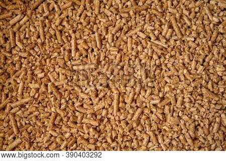 Natural Wooden Pellets Background Or Pattern. The Cat Litter. ?lose Up Natural Wood Pellet. Ecologic