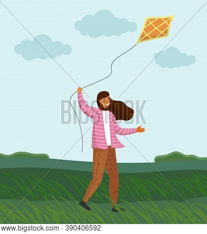 Girl In Pink Striped Sweater, Long Hair, Brown Pants In Windy Weather Launches Orange Kite On Grassy