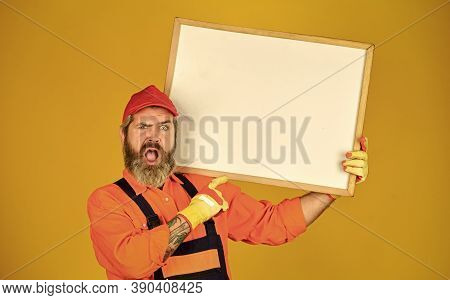 Builder Enjoy Success. Builder Men Points On Flipchart. Engineer Project, Copy Space. Architect And