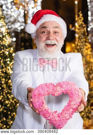 Charity And Kindness. Santa Claus. Mature Man With White Beard. Christmas Eve. Senior Man Celebrate