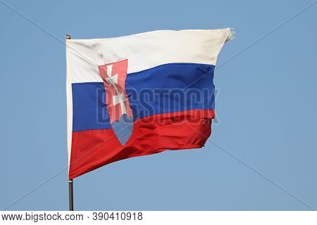 Slovakian Flag Flying On Flagpole On Blue Sky Background