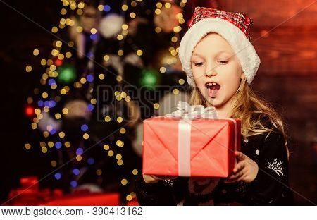 Best Surprise Gift Ever. Adorable Kid Looking At Gift Box With Surprise. Small Girl Keeping Mouth Op