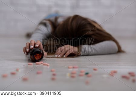 Millennial Lady Committing Suicide By Overdosing On Antidepressants, Selective Focus On Hand Holding