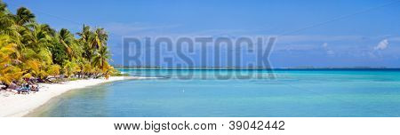 Beautiful beach at little tropical island in French Polynesia