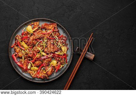Kkanpunggi Or Korean Spicy Garlic Fried Chicken On Black Plate On Dark Slate Table Top. Kan Pung Gi