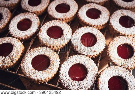 Homemade Traditional Linzer Christmas Cookies With Strawberry Jam.  Background With Short Depth Of F
