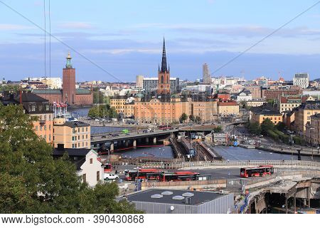 Stockholm City In Sweden. Slussen Area With City Buses Street Traffic And Urban Skyline.