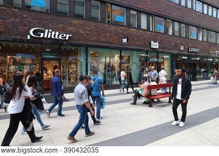 Stockholm, Sweden - August 23, 2018: People Visit Drottninggatan Shopping Street In Norrmalm Distric