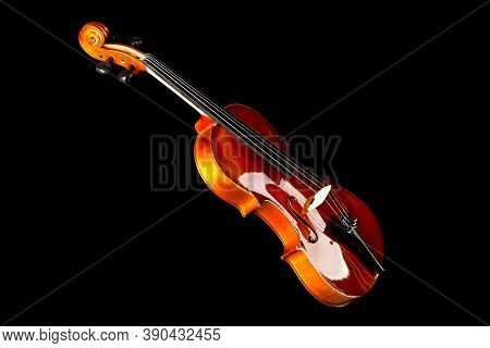 Brown Wooden Fiddle Or Violin, Classic Musical Instrument, Isolated Over Black Background, Selective