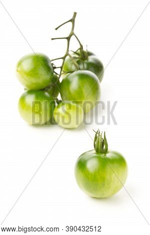Bundle Of Unripe Green Tomatoes Over White Background, Unripe Tomatoes Can Be Fried Or Used For Reli