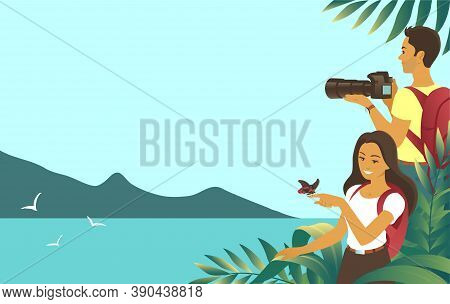 Young Couple Travel In The Jungle. Seashore In The Background. A Man Takes Pictures With A Camera. G