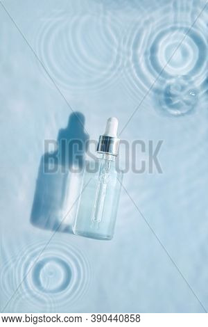Cosmetic Spa Medical Skin Care, Bottle For Serum, Micellar Toner And Emulsion On Water Texture Backg