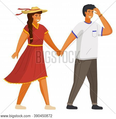 Couple Walking Together. Young Guy And Girl Wearing A Light Dress And A Straw Hat Holding Hands Walk