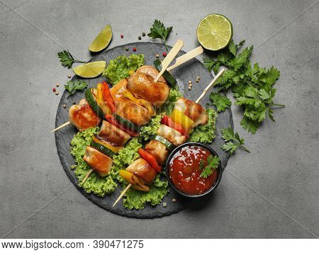 Delicious Chicken Shish Kebabs With Vegetables On Grey Table, Flat Lay
