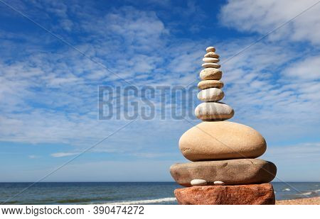 Rock Zen Pyramid Of White And Pink Pebbles On The Beach. Concept Of Life Balance, Harmony And Medita