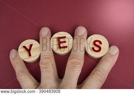 Yes Sign On A Wooden Circles On A Red