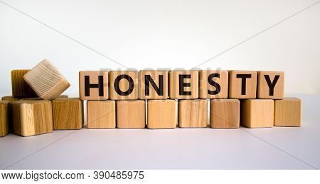 Honesty Word Written On Wood Cubes. Honesty Text On Table, Business Concept. Beautiful White Backgro