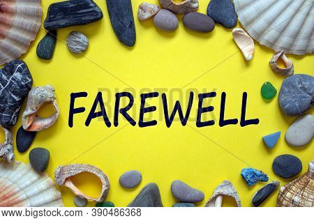Text 'farewell' On A Beautiful Yellow Background. Sea Stones And Seashells. Concept.