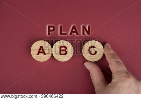 Plan A B C  Sign On A Wooden Circles On A Red
