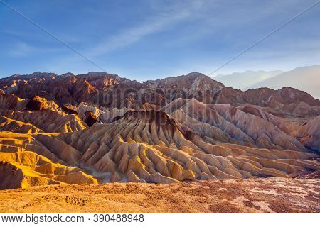 Zabriskie Point is part of the Amargosa Range. Death Valley in California, USA. Magnificent landscape and a variety of shades. Sunset. The concept of active, extreme and photo tourism