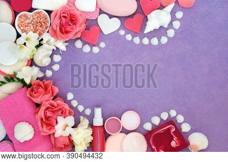 Natural beauty treatment ingredients for skin and body care forming an abstract background border. Flat lay on mottled purple background. Health care concept bio organic and suitable for vegans.