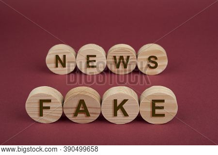 Blank Wooden Circles For Conceptual Sign On A Red. Fake News