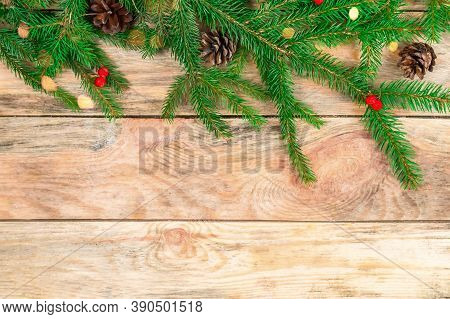 Branches Of A Christmas Tree On A Wooden Background With Cones, Rowan Berries With Copy Space, Top V