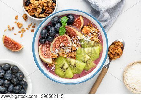 Acai Smoothie Bowl With Superfoods Seeds Blueberry Fig Kiwi Granola. Top View. Vegan Smoothie