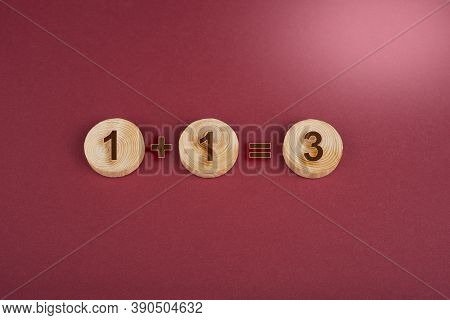 Wooden Circles For Conceptual Sign On A Red. 1+1=3. Nonsense Concept
