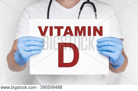 The Male Doctor Holding A Card With Vitamin D Text, Medical Concept. Treatment And Prevention With V