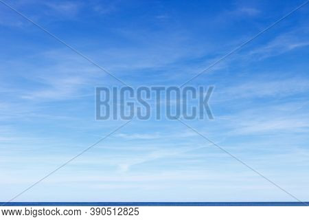 Beautiful Blue Sky With Cirrus Clouds Over The Sea. Skyline