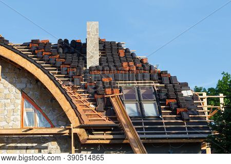Repair Of A Roof Made Of Ceramic Tiles With Skylight Windows