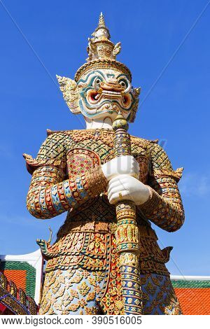 Demon Guardian Close-up Against A Blue Sky, In Wat Phra Kaew (temple Of The Emerald Buddha), Grand P