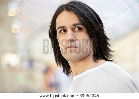 Portrait of dark-haired brown-eyed man