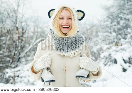 Funny Winter Girl Is Going Skate Outdoors. Beautiful Young Woman Laughing Outdoors. Beautiful Winter