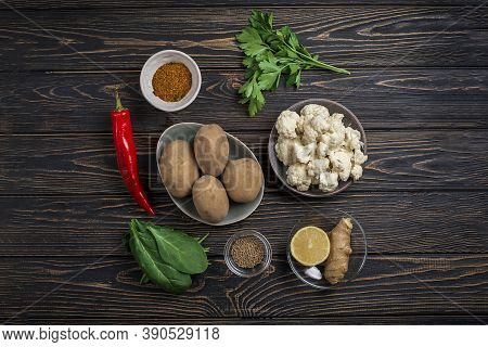 Aloo Gobi Ingredient Set. Traditional Vegetarian Indian Curry Dish With Potatoes, Cauliflower, Spina
