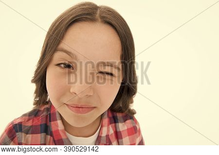 Children Skincare. Beauty Look Of Skincare Model. Small Girl Wink With Healthy Face Skin. Skincare R