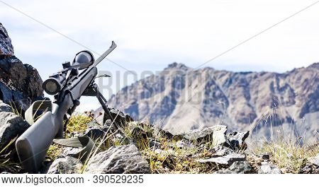 Small Arms With A Telescopic Sight On Bipods, In The Mountains Against The Sky. The Rifle With Sight