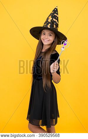 Happy Kid Wear Witch Hat Holding Magic Wand To Create Enchantment On Halloween, Halloween Magic.