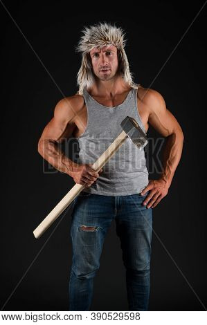 Dont Stop Till You Drop. Fit Man Hold Hammer Black Background. Working Man With Biceps Triceps. Mine